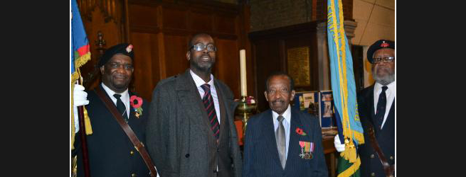 WAR HEROES: Patrick Vernon OBE (second left) with Neil Flanagan MBE and members of the association